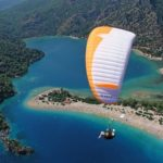 SH Paragliding over island